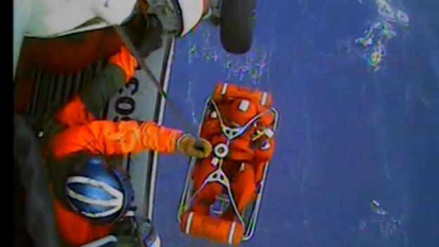 A screen grab from video of the Coast Guard's rescue operation that saved 14 sailors from the HMS Bounty on Monday. (U.S. Coast Guard)