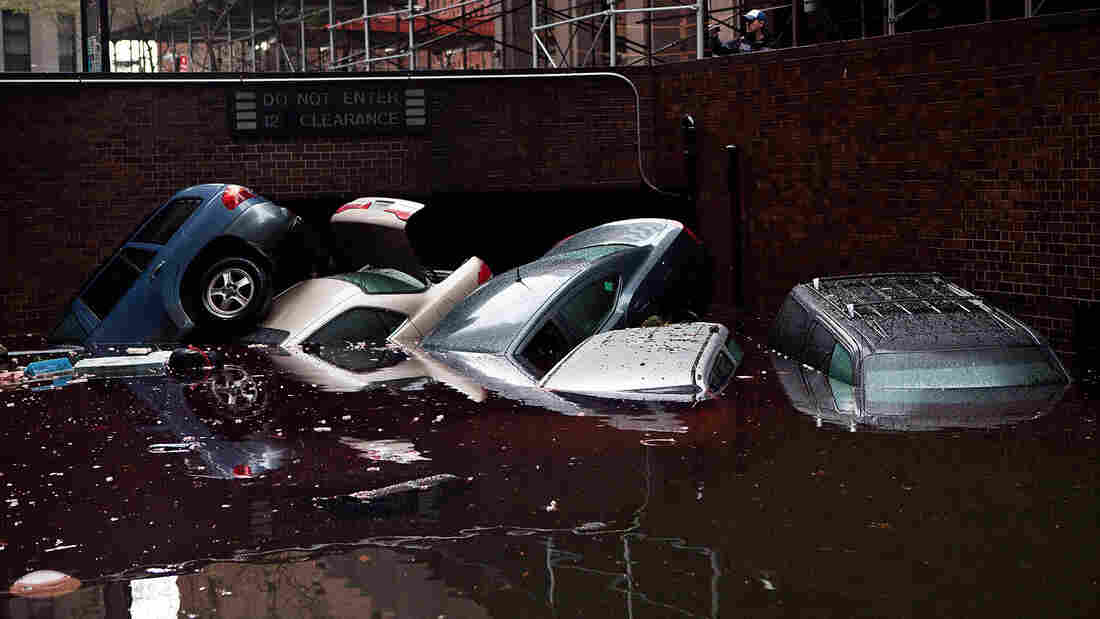 In New York City's financial district, cars floated in a flooded subterranean basement a day after Hurricane Sandy tore across the East Coast.