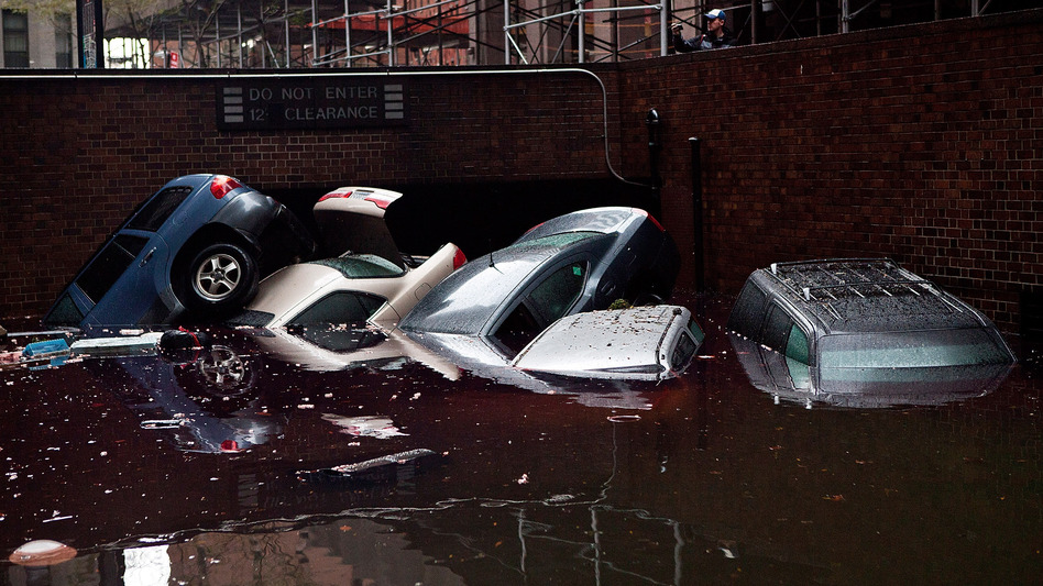 In New York City's financial district, cars floated in a flooded subterranean basement a day after Hurricane Sandy tore across the East Coast. (Getty Images)