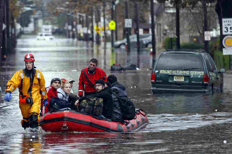 Emergency personnel rescue residents from flood waters brought on by Sandy in Little Ferry, N.J.