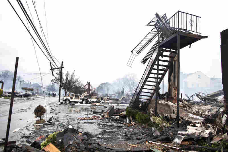 Dozens of homes and vehicles have been destroyed after a fire caused by Sandy, in Breezy Point neighborhood of Queens, N.Y. More than 190 firefighters contained the six-alarm blaze. According to The Associated Press, projected storm damage is between $10 billion and $20 billion.