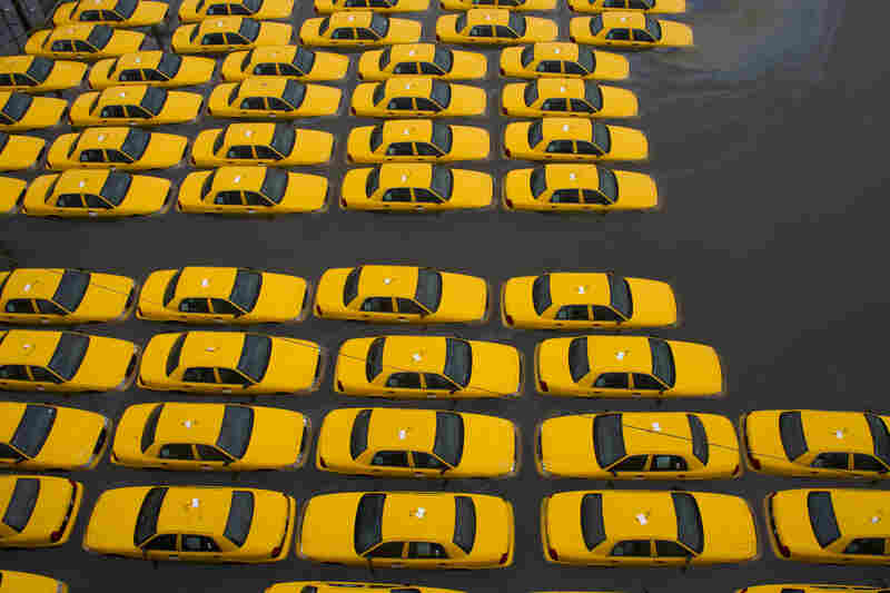 A parking lot full of yellow cabs is flooded as a result of Hurricane Sandy in Hoboken, N.J.
