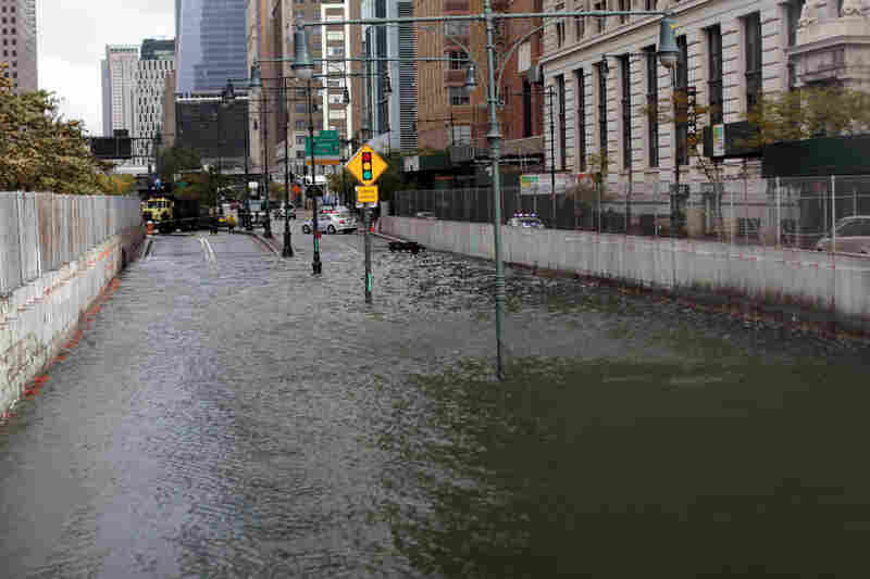 The Brooklyn Battery Tunnel is flooded after a tidal surge caused by Sandy. According to The Associated Press, it's now thought there have been at least 33 deaths, including at least 17 in New York State.