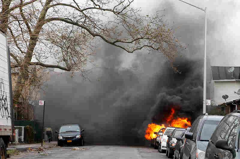 A car is seen on fire in the Brighton Beach neighborhood of Brooklyn, N.Y.