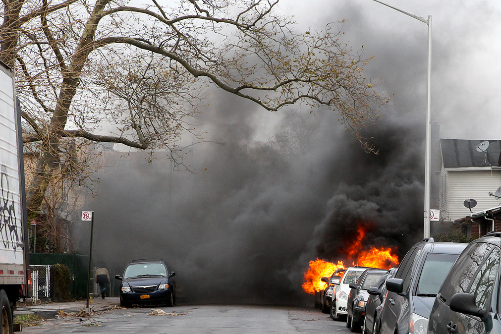 A car is seen on fire in the Brighton Beach neighborhood of Brooklyn, N.Y.
