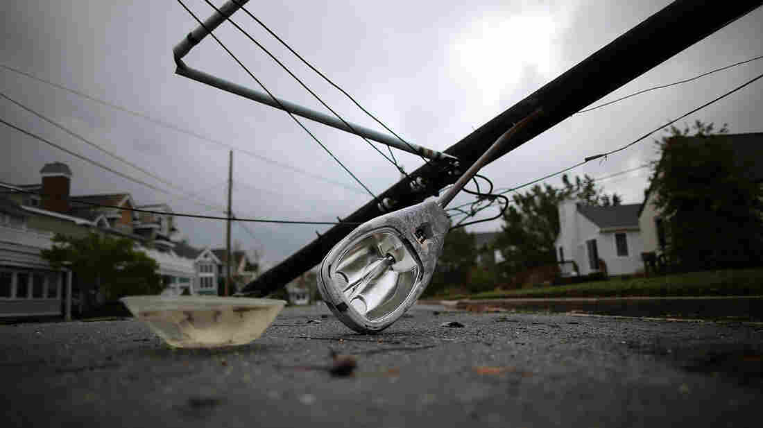 A street light and utility pole brought down by Hurricane Sandy lay on the street in Avalon, N.J. About 2.5