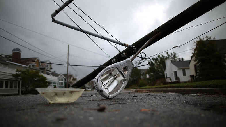 A street light and utility pole brought down by Hurricane Sandy lay on the street in Avalon, N.J. About 2.5 million customers had no power Tuesday in New Jersey.