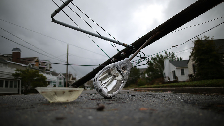 A street light and utility pole brought down by Hurricane Sandy lay on the street in Avalon, N.J. About 2.5 million customers had no power Tuesday in New Jersey. (Getty Images)