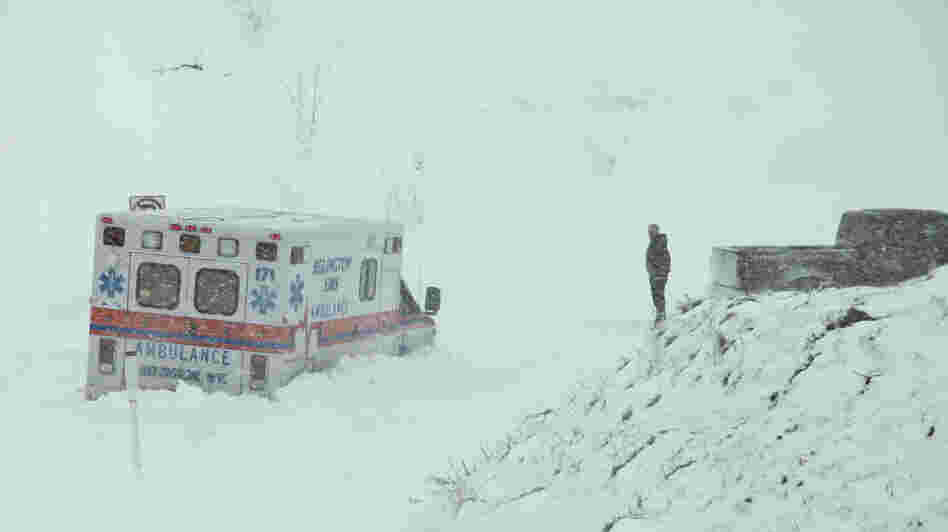 An ambulance is stuck in over a foot of snow off of Highway 33 West, near Belington, W.Va. on Oct. 30. Superstorm Sandy buried parts of West Virginia under more than a foot of snow.