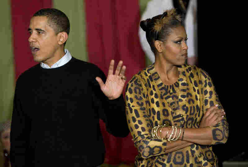 President Obama is trying to justify his lack of costume and Michelle is NOT. HAVING. IT. This is what happens when you don't dress up. (The Obamas greet trick-or-treaters at the White House in 2009.)