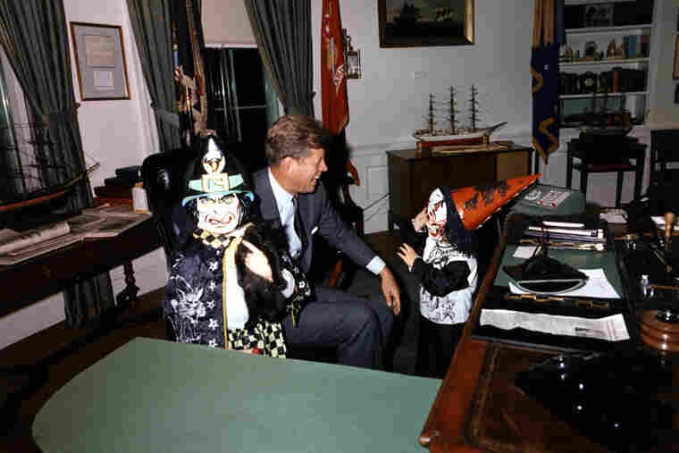 President John F. Kennedy Jr., greets Halloween visitors in the Oval Office, 1963. Bonus: That is a kitten in the child's hand on the left.
