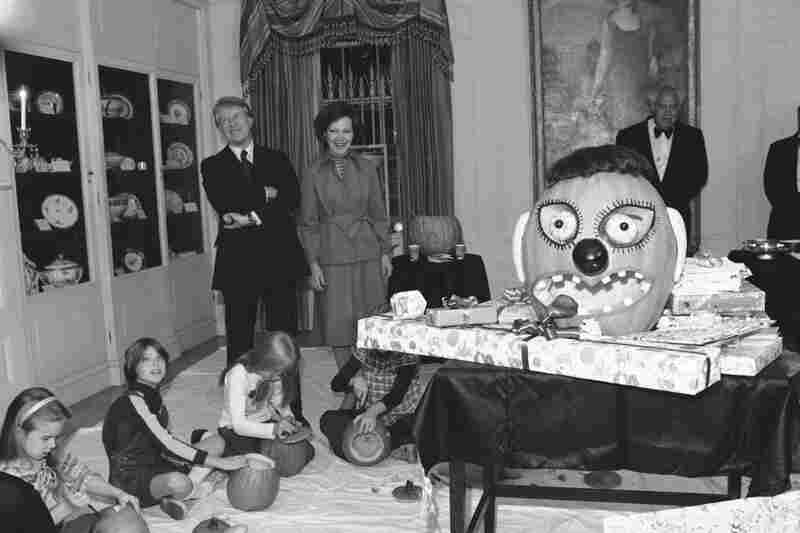 President Jimmy Carter and first lady, Rosalynn, watch their daughter, Amy, and her friends carve pumpkins for Amy's 10th birthday party. (One of many reasons why it pays to have friends with October birthdays.)