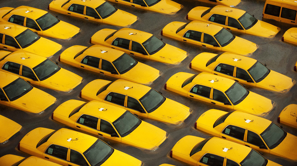 Taxis sit in a flooded lot in Hoboken, N.J., after Hurricane Sandy caused massive flooding across much of the Atlantic Seaboard. (Getty Images)