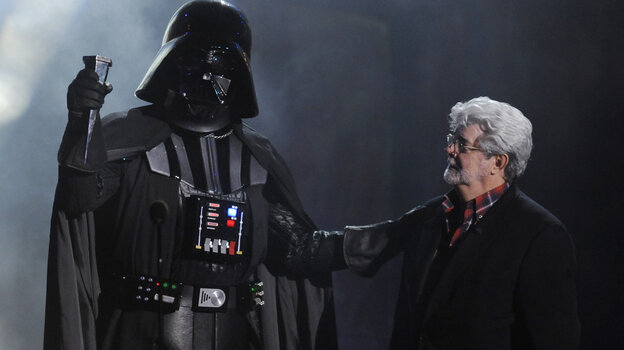 "In this Oct. 15, 2011 file photo, ""Darth Vader"" accepts the Ultimate Villain award from Star Wars creator George Lucas during the 2011 Scream Awards."