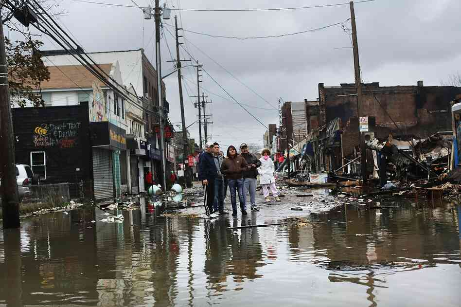 People look at homes and businesses destroyed during Superst