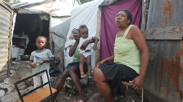 Hurricane Sandy's tear across the Caribbean left at least 54 dead in Haiti, where many people still live in tents because of damage from the 2010 earthquake. (AFP/Getty Images)