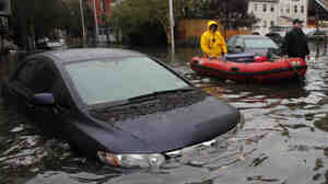 Rescue in Hoboken: Much of the New Jersey city remains flooded and the National Guard has been called in to help rescue stranded residents. Tuesday, this was the scene on one of the city's flooded streets.