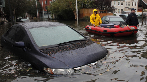 Rescue in Hoboken: Much of the New Jersey city remains flooded and the National Guard has been called in to help rescue stranded residents. Tuesday, this was the scene on one of the city's flooded streets. (Reuters /Landov)