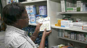 Dr. Esther Dalizu holds a pack of Coartem Malaria drugs in a pharmacy in Nairobi, Kenya, last year.