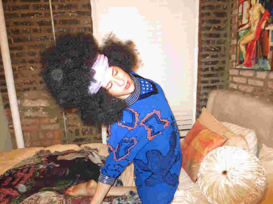 Michelle Joni Lapidos sports a big afro wig.