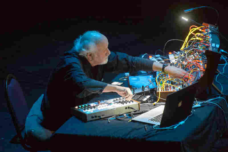 Morton Subotnick works the controls for a synthesizer originally designed by Don Buchla in the 1960s. Subotnick used a similar one to record Silver Apples of the Moon.