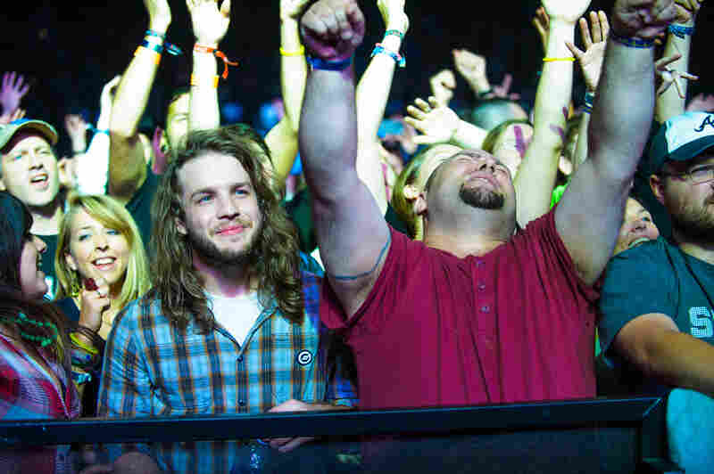 Fans lose themselves in a performance by the English electronic dance group Orbital, at the Explore Asheville Arena.