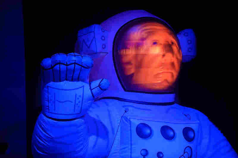 "A grim-faced ""Big Brother"" spaceman waves to fans during Primus' show at the Explore Asheville Arena."