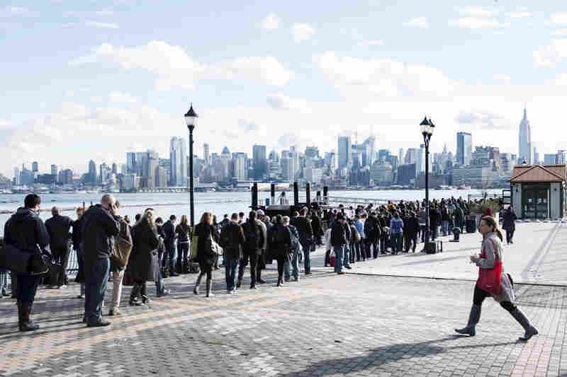 With limited transportation options, people wait for ferry tickets in Hoboken, N.J., on Wednesday.