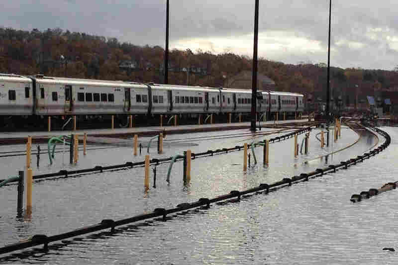 Trains stand in a flooded Metro-North Harmon Yard in Croton-on-Hudson, N.Y., on Wednesday.