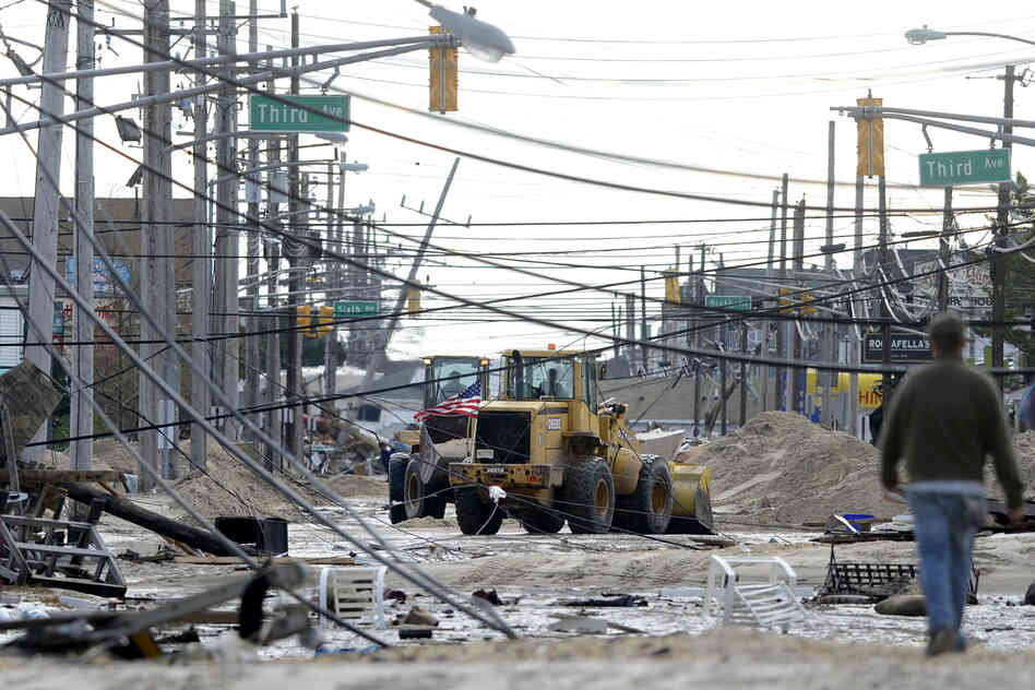 Streets are covered with fallen power lines and debris following heavy damage by Sandy, in Seaside Heights, N.J., on Wednesday.