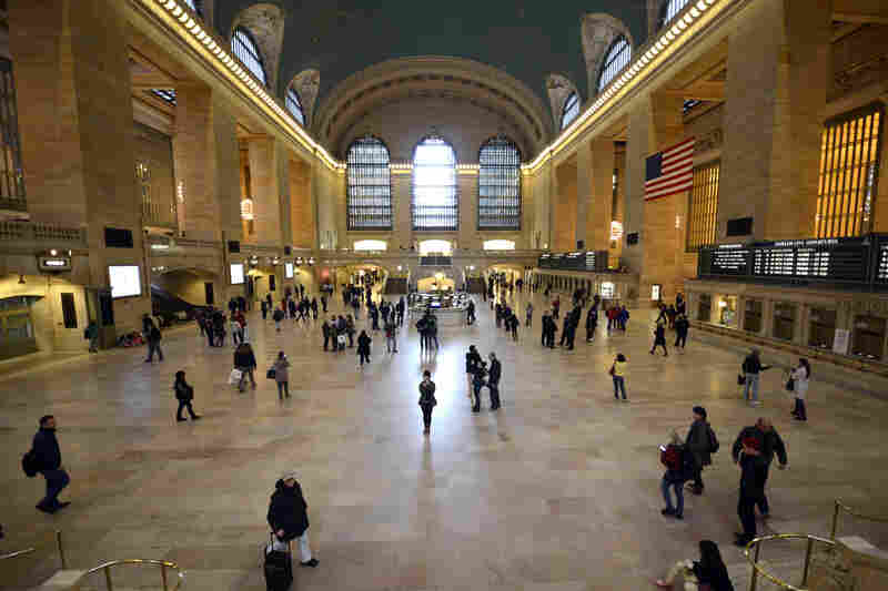 Travelers in Grand Central Station after the MTA opened up the railroad and subways on a limited schedule in New York City.