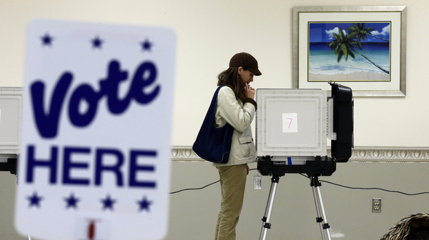 Kimberly Fisher cast her ballot Wednesday at a polling place at the Wicomico County Youth and Civic Center in Salisbury, Md. (AP)