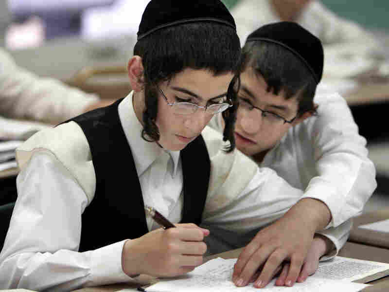Two boys study together at a Chicago yeshiva in 2009. Public health officials say this type of close physical contact caused a mumps outbreak to spread throughout several orthodox Jewish communities in and around New York City.