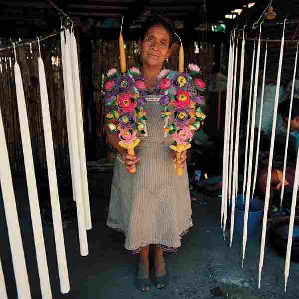 Biviana Alvarez Hipolito, candle maker, Teotitlan del Valle, Oaxaca. Every petal of the wax flowers is handmade from wax molds.