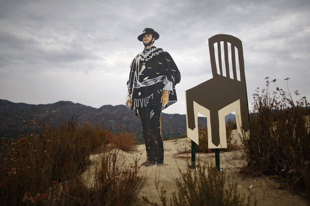 A life-sized cardboard cutout of actor, director and politician Clint Eastwood stands next to an empty chair cutout north of Los Angeles, California. Eastwood's 12-minute conversation with an empty chair representing President Obama sparked much attention at the 2012 Republican National Convention.