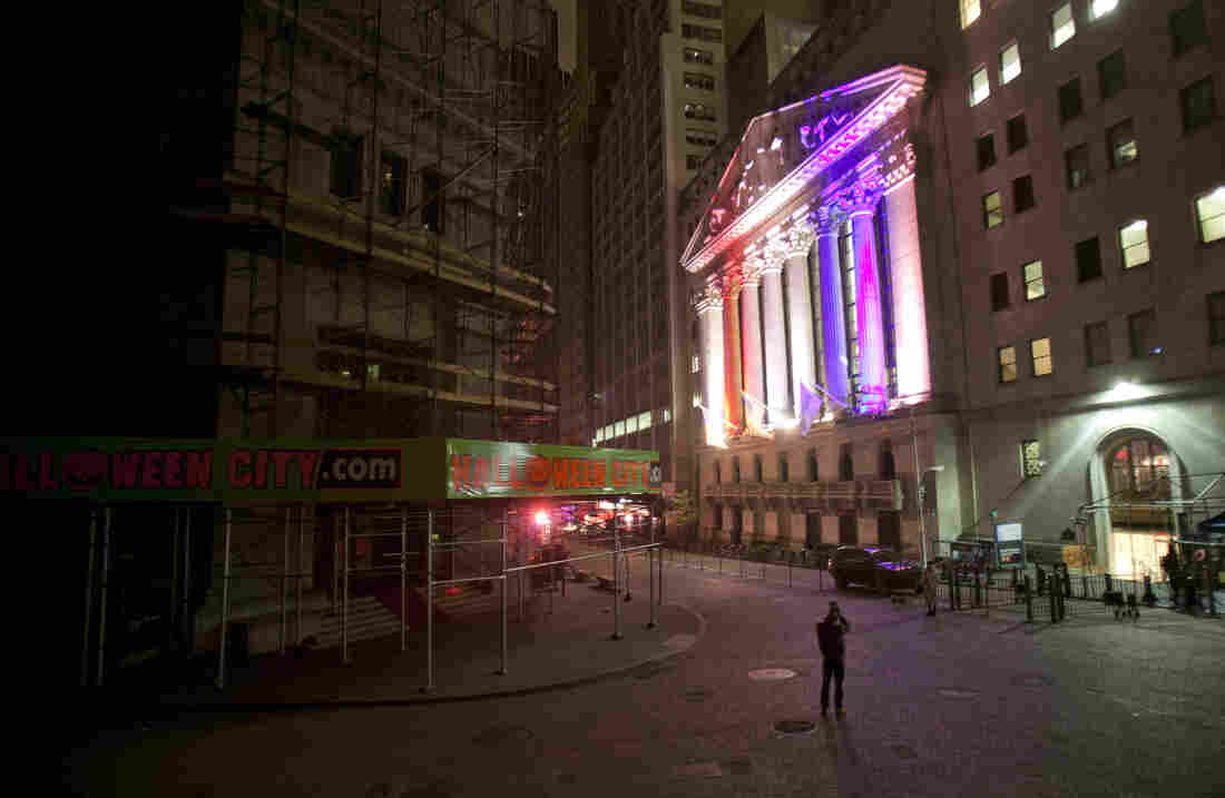 A man takes a photo of the New York Stock Exchange.