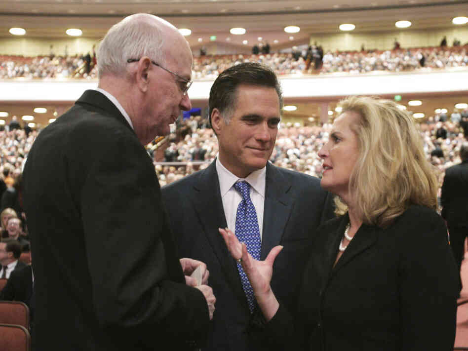 Mitt Romney, his wife, Ann, and then-Sen. Robert Bennett, R-Utah, attend the 2008 funeral of Gordon B. Hinckley, president of the Church of Jesus Christ of Latter-day Saints, in Salt Lake City.
