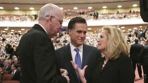 Mitt Romney, his wife, Ann, and then-Sen. Robert Bennett, R-Utah, attend the 2008 funeral of Gordon B. Hinckley, president of the Church of Jesus Christ of Latter-day Saints, in Salt Lake City.