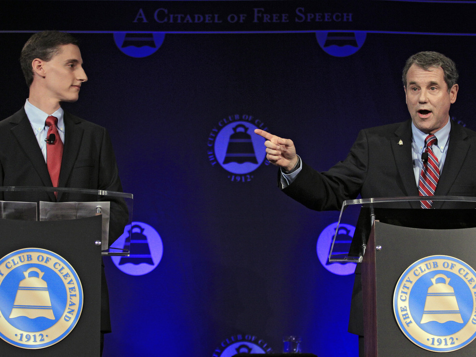 U.S. Sen. Sherrod Brown (right), D-Ohio, debates his Republican challenger, Ohio state Treasurer Josh Mandel, at the City Club in Cleveland on Oct. 15.