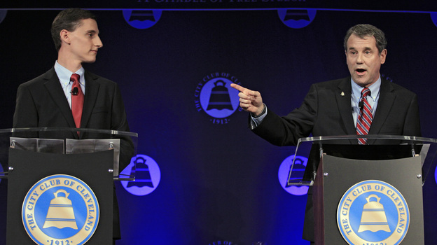 U.S. Sen. Sherrod Brown (right), D-Ohio, debates his Republican challenger, Ohio state Treasurer Josh Mandel, at the City Club in Cleveland on Oct. 15. (AP)