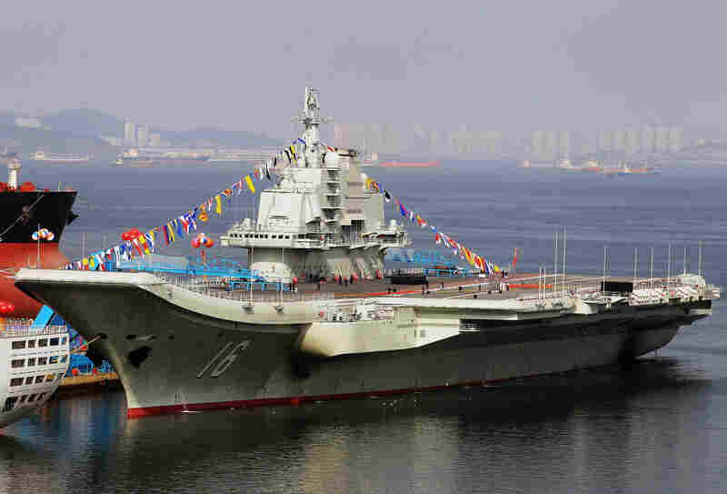 China's first aircraft carrier, shown here in the northeastern port of Dalian, was officially put into service on Sept. 25. The carrier is seen as a symbol of China's growing military might.