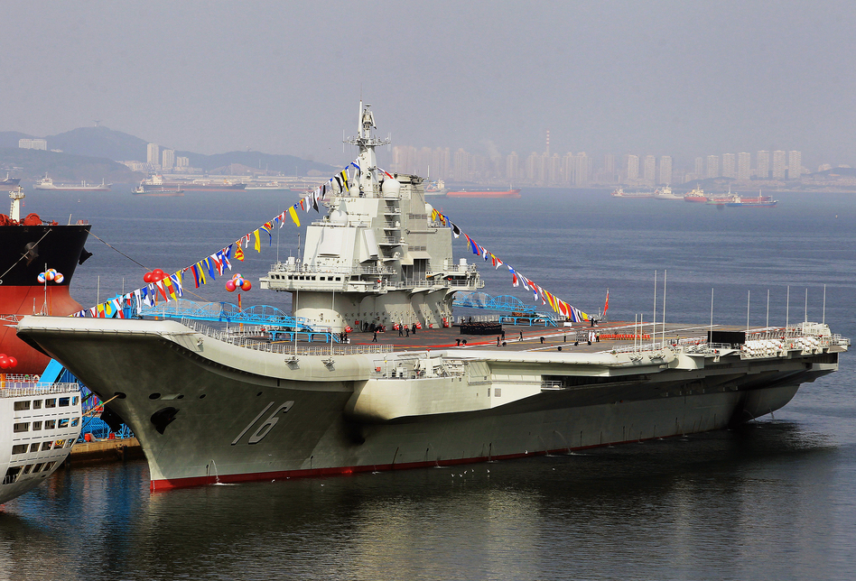 China's first aircraft carrier, shown here in the northeastern port of Dalian, was officially put into service on Sept. 25. The carrier is seen as a symbol of China's growing military might. (AFP/Getty Images)