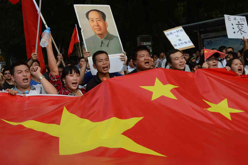 Chinese demonstrators carry their nation's flag during an anti-Japanese protest outside the Japanese Embassy in Beijing on Sept. 15. The countries are involved in a dispute over the Diaoyu Islands, known as