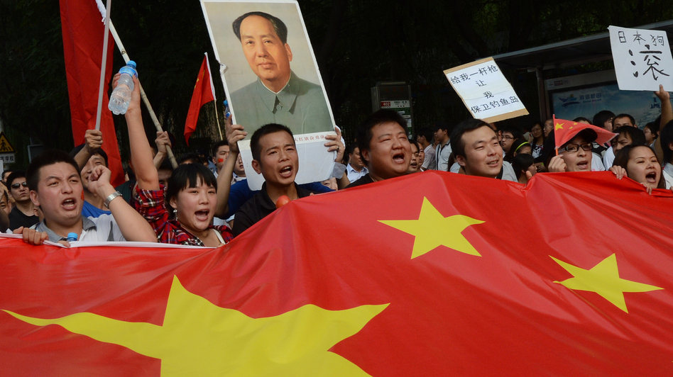 Chinese demonstrators carry their nation's flag during an anti-Japanese protest outside the Japanese Embassy in Beijing on Sept. 15. The countries are involved in a dispute over the Diaoyu Islands, known as the Senkaku Islands in Japanese. (AFP/Getty Images)