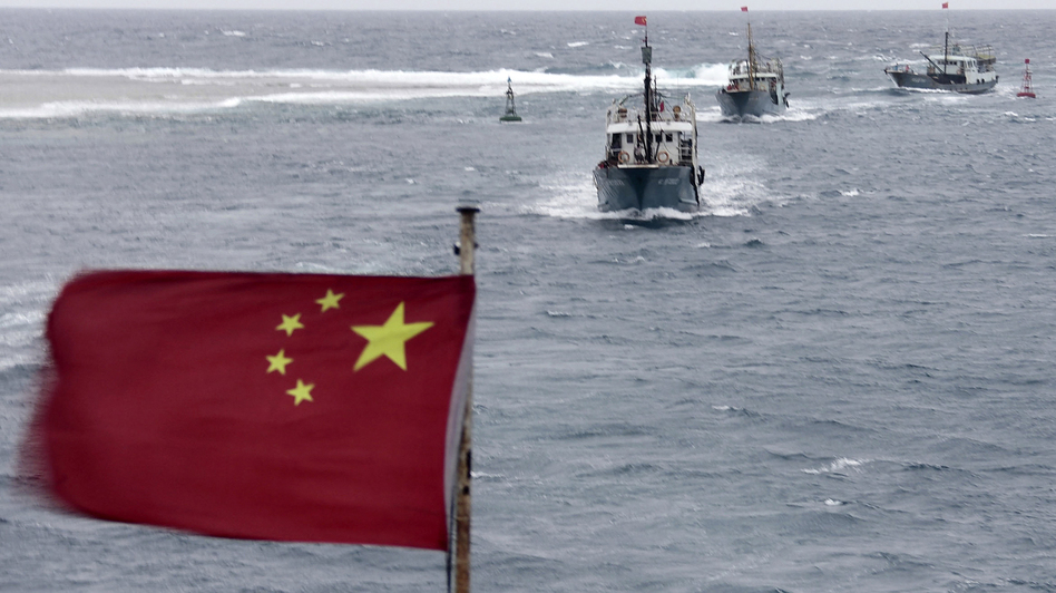 China is currently involved in several disputes with its neighbors over small islands, many of them uninhabited. Here, Chinese fishing boats sail off the island province of Hainan in the South China Sea in July. (AP)