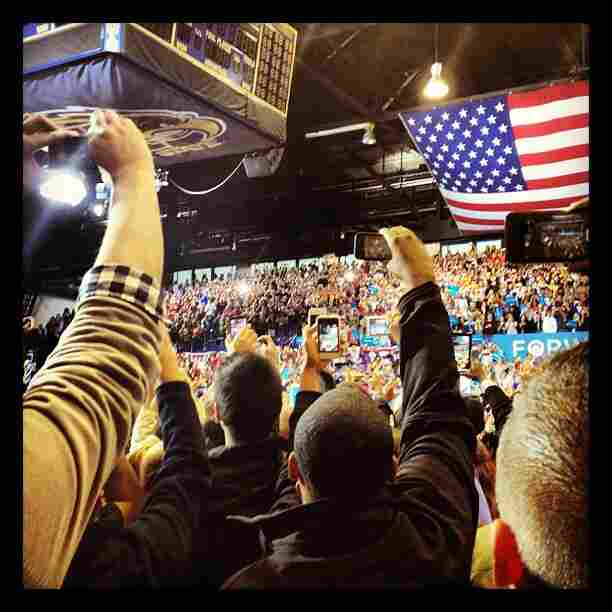 White House Correspondent Ari Shapiro stood among a crowd of spectators with their smartphone cameras held high, hoping to snap a shot of President Obama during a campaign rally. We suspect Shapiro was not the only onlooker who posted his photo to Instagram afterwards.