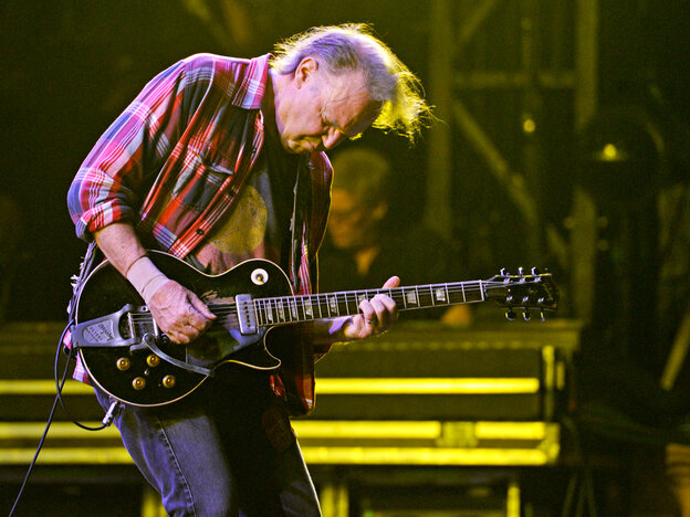 Neil Young, who turns 67 years old this month, performs with Crazy Horse on Oct. 26 in New Orleans. In recent concerts the group has focused mostly on material from its new album, Psychedelic Pill.
