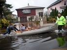 An emergency responder helps residents of Little Ferry, N.J., after their neighborhood was flooded due to Superstorm Sandy.