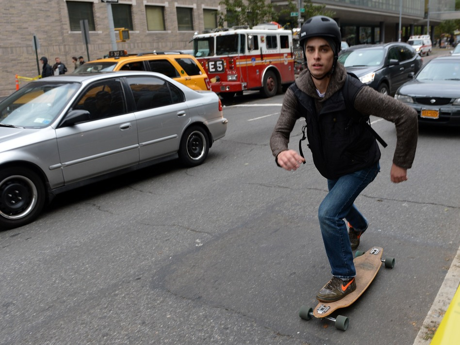 That's one way to get around: A skateboarder Wednesday on First Avenue in Manhattan. (Stan Honda /AFP/Getty Images)