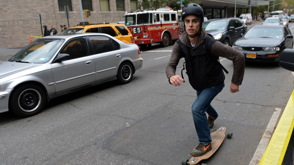 That's one way to get around: A skateboarder Wednesday on First Avenue in Manhattan. (AFP/Getty Images)
